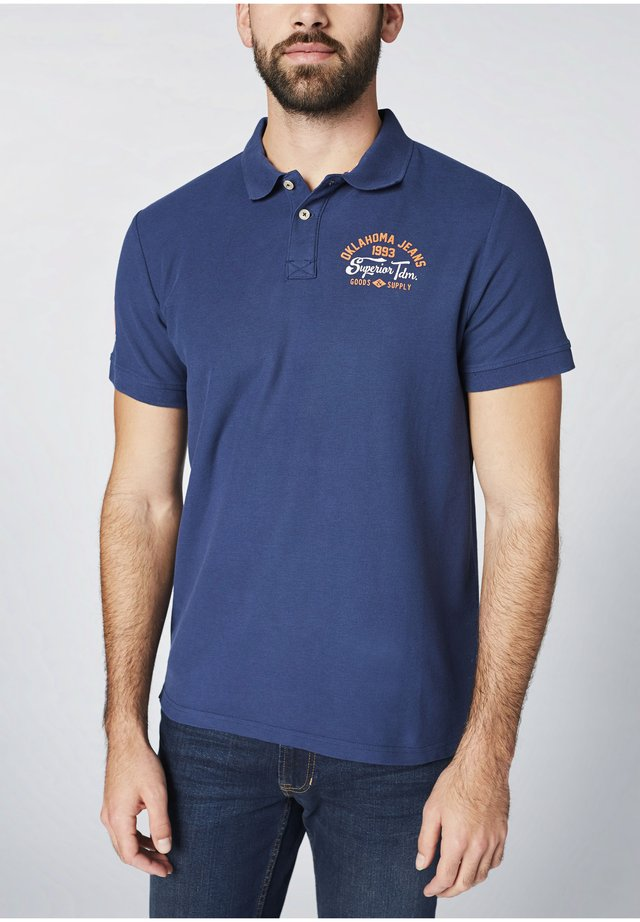 Polo shirt - insignia blu