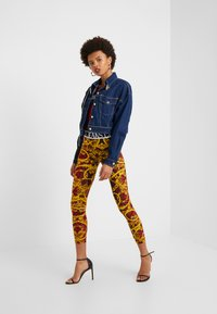Versace Jeans Couture - LADY FUSEAUX - Leggings - racing red - 1