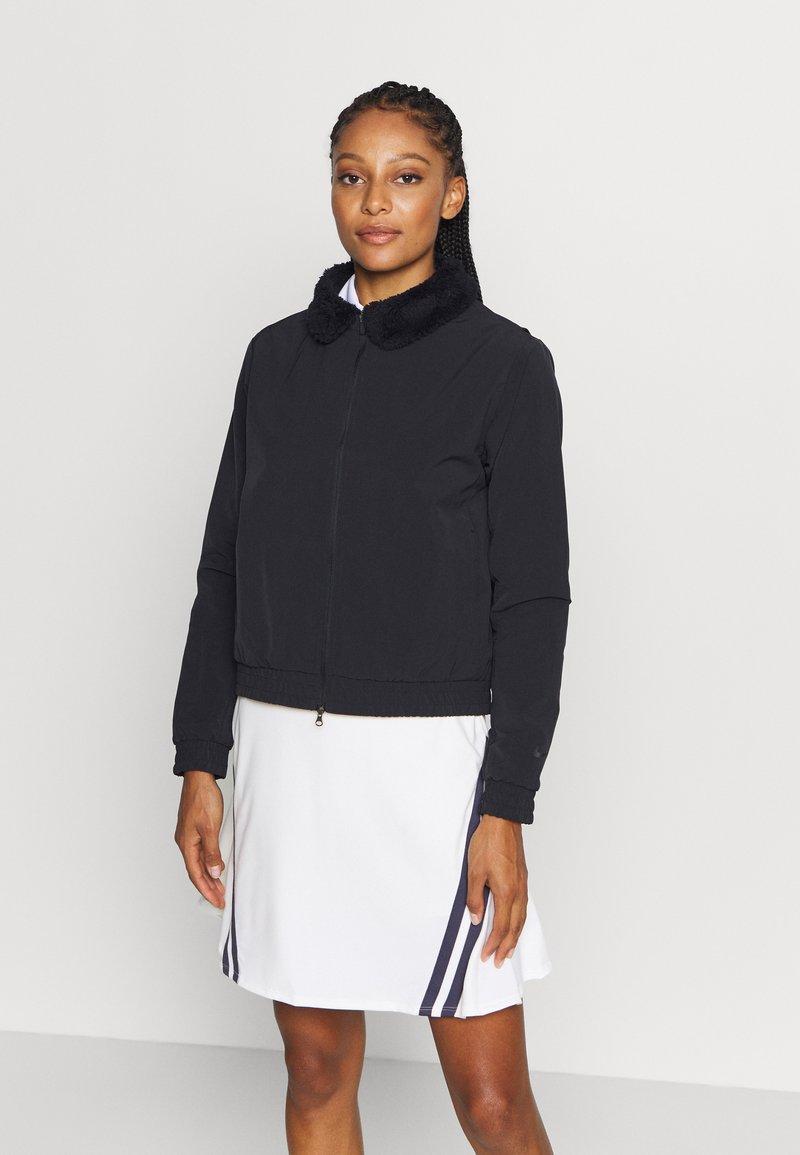 Nike Golf - Softshellová bunda - black