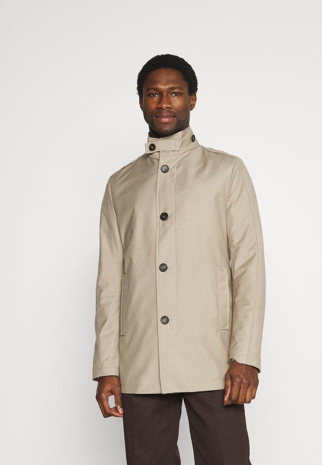 CISCAD - Halflange jas - beige