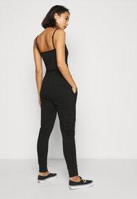 Fila Petite - EIDER PANTS - Pantaloni sportivi - black - 2