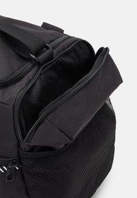 Puma - FUNDAMENTALS SPORTS BAG M UNISEX - Sportovní taška - black - 3
