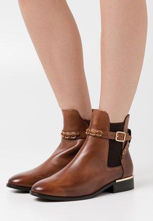 PARADISE - Classic ankle boots - cognac