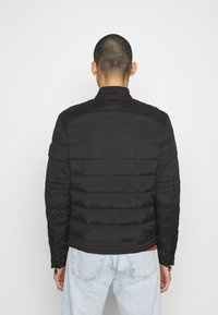 Calvin Klein Jeans - QUILTED PADDED MOTO JACKET - Light jacket - black - 2