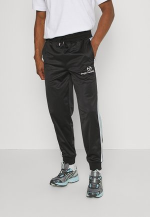 ANDERSON TRACKPANT - Tracksuit bottoms - black/green/white