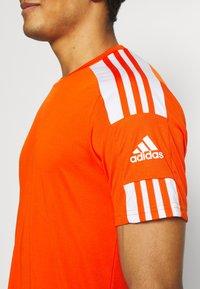 adidas Performance - SQUAD 21 - T-shirt z nadrukiem - teaora/white - 4