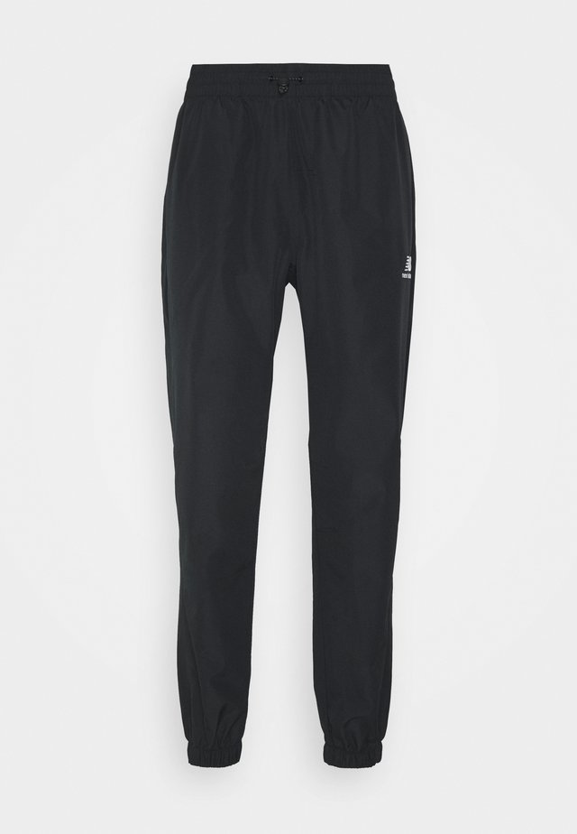 ATHLETICS WIND PANT - Pantalon de survêtement - black