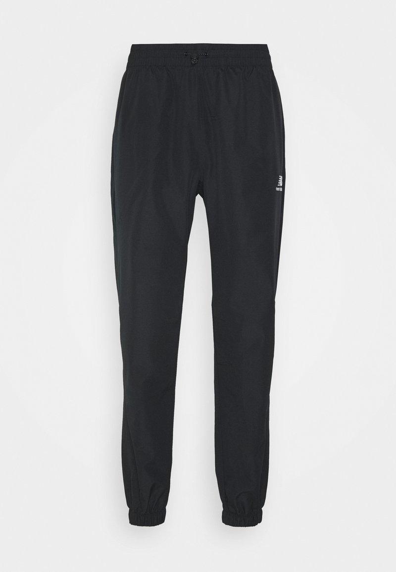 New Balance - ATHLETICS WIND PANT - Tracksuit bottoms - black