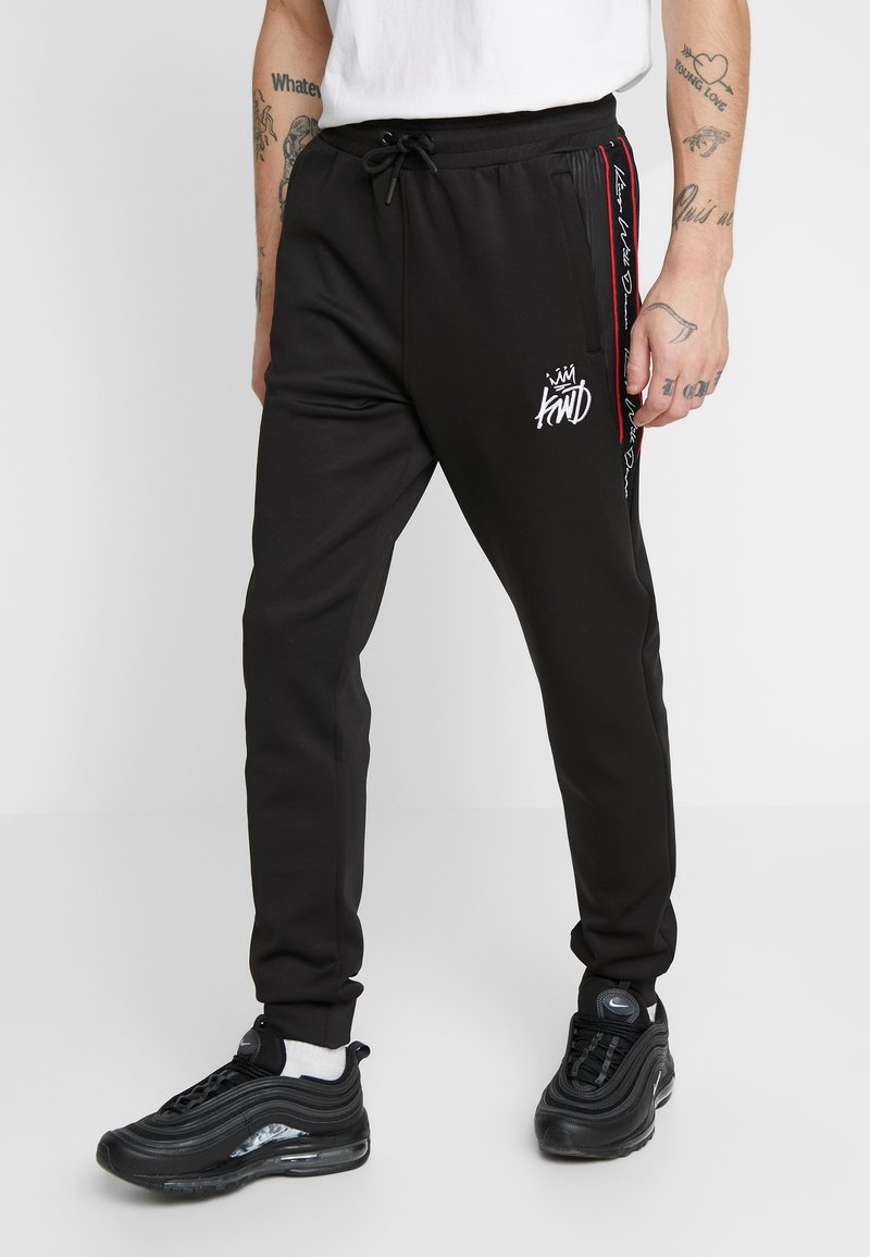 Kings Will Dream - DEFLOUR JOGGERS WITH TAPING - Tracksuit bottoms - black