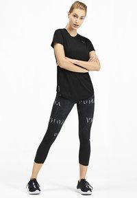Puma - IGNITE - Basic T-shirt - black - 1