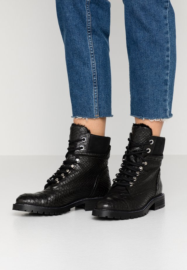 Lace-up ankle boots - black oslo