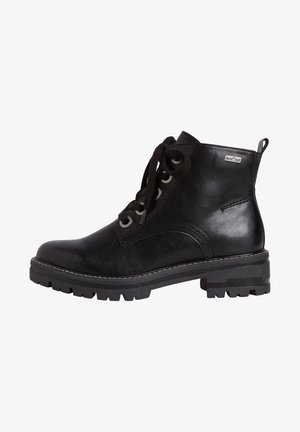 STIEFELETTE - Platform ankle boots - black