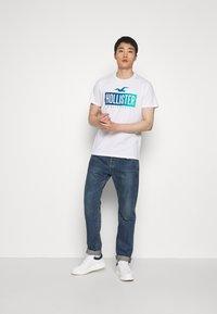 Hollister Co. - PRINT LOGO - Print T-shirt - white - 1