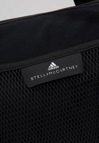 adidas by Stella McCartney - ROUND DUFFEL S - Sports bag - black/black/white - 6