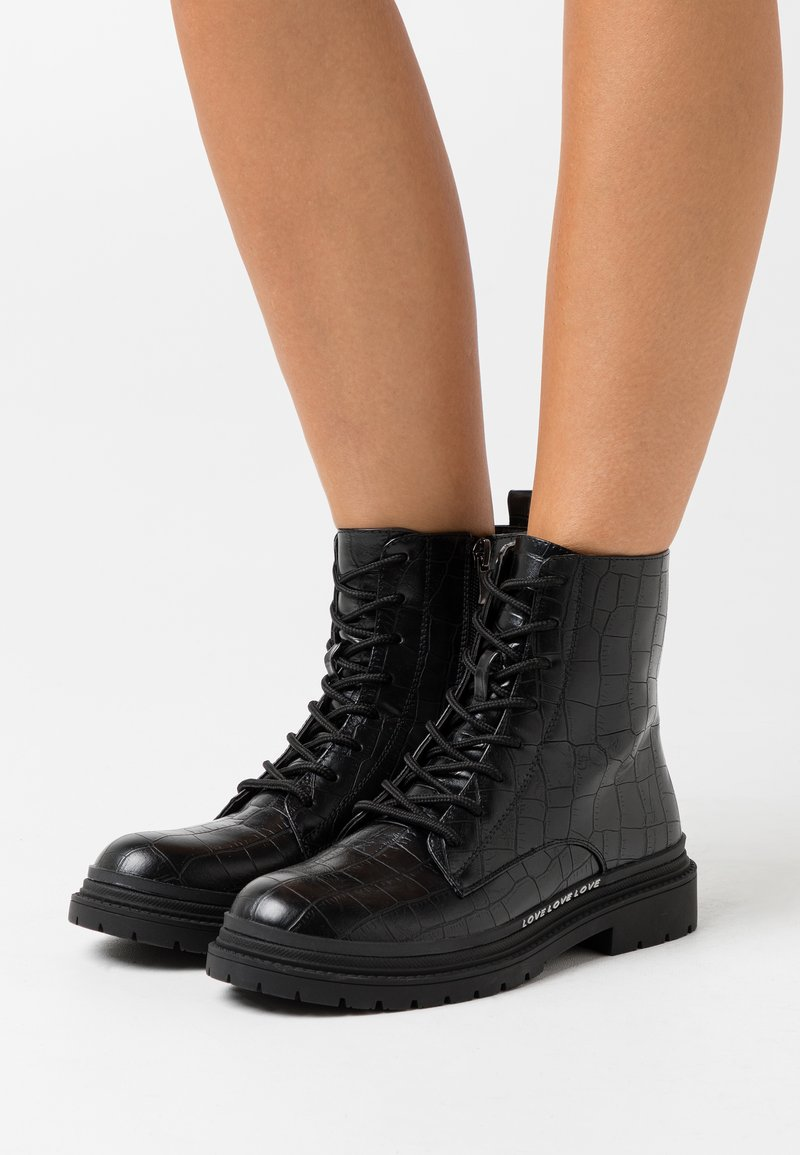 KHARISMA - Lace-up ankle boots - nero