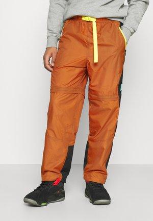 TRACK PANT - Spodnie treningowe - monarch/black/opti yellow