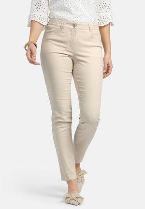 JULIENNE - Trousers - beige