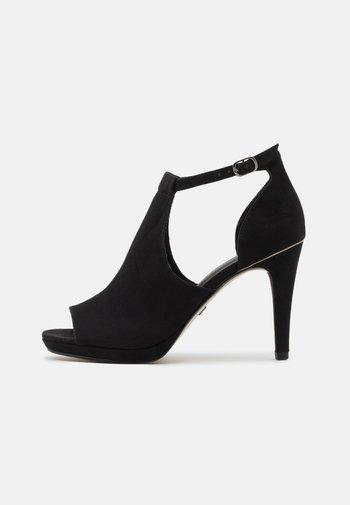 Peeptoe heels - black