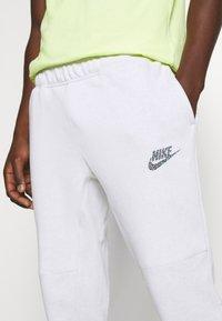 Nike Sportswear - Pantalon de survêtement - pure - 4