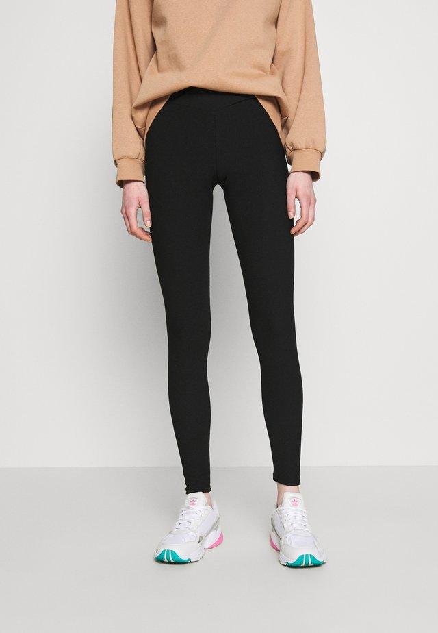 CROSS WAIST - Leggings - Trousers - black