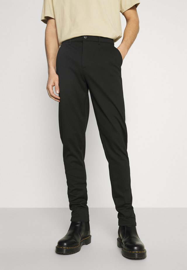 DAVE BARRO - Trousers - black
