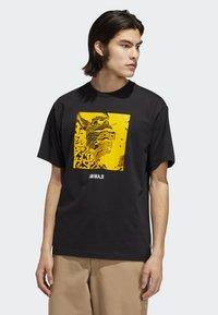 adidas Originals - MANOLES ALIAS T-SHIRT - Print T-shirt - black - 0