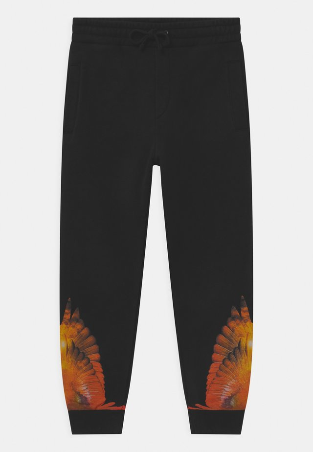 WINGS PLANET - Tracksuit bottoms - nero