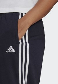 adidas Performance - ADIDAS ESSENTIALS FRENCH TERRY 3-STRIPES PANTS (PLUS SIZE) - Tracksuit bottoms - legink/white - 3