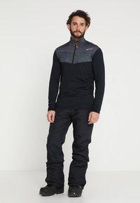 Brunotti - FOOTSTRAP MEN SNOWPANTS - Snow pants - black - 1