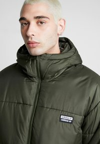 adidas Originals - REVEAL YOUR VOICE JACKET - Winter jacket - night cargo - 3