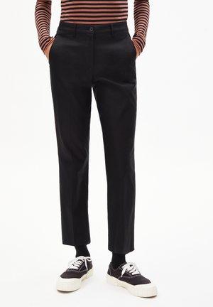 VARMAA SOLID - Trousers - black