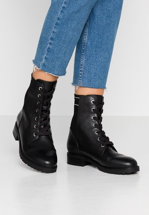 OHSOMICKEY DISNEY - Lace-up ankle boots - black