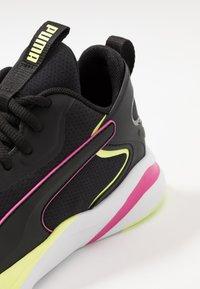 Puma - SOFTRIDE RIFT TECH - Zapatillas de running neutras - black/fizzy yellow - 5