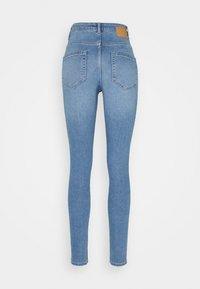 Pieces - PCMIDFIVE FLEX - Jeans Skinny Fit - light blue denim - 1