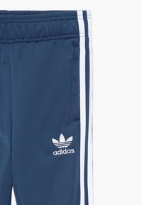 adidas Originals - SUPERSTAR PANTS - Tracksuit bottoms - marin/white - 3