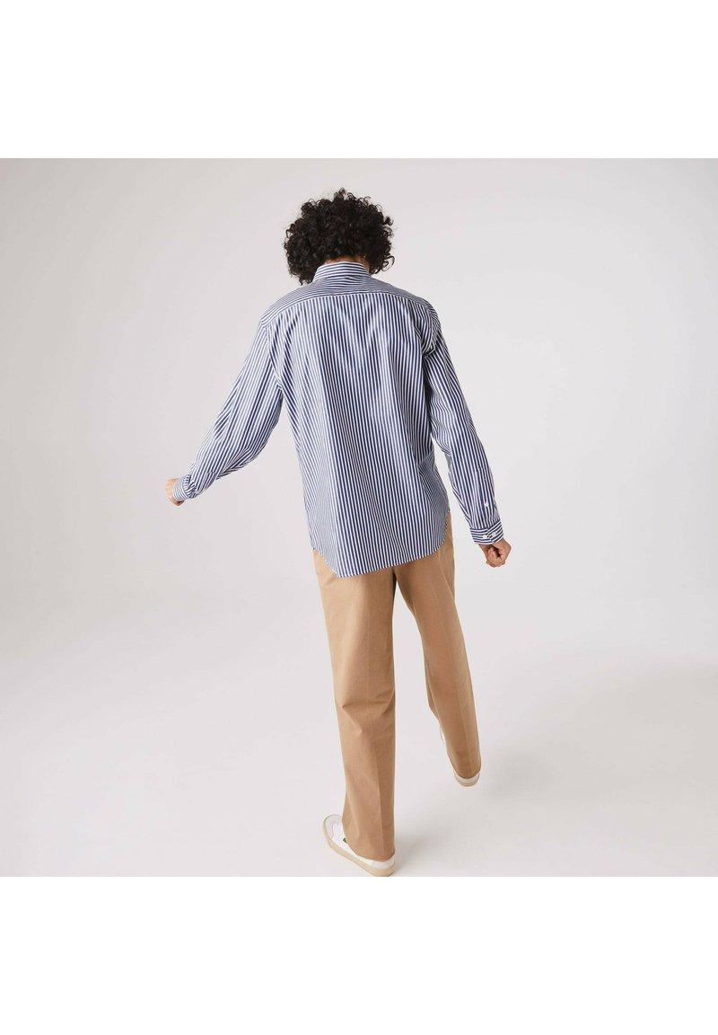 Lacoste - Shirt - weiß / blau