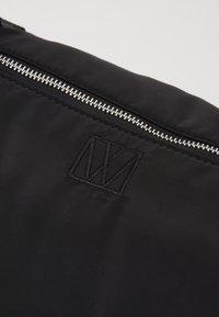 InWear - TRAVEL WEEKEND BAG - Weekend bag - black - 4