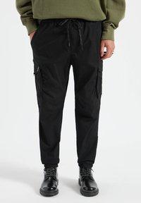 PULL&BEAR - Cargo trousers - mottled black - 0