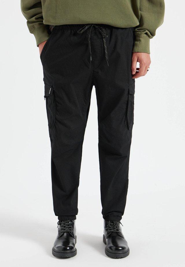 Kapsáče - mottled black