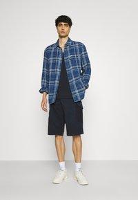 s.Oliver - BERMUDA - Shorts - dark blue - 1