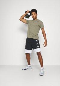 Nike Performance - TEE CREW SOLID - Basic T-shirt - light army/black - 1