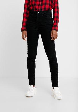 SKINNY - Trousers - true black