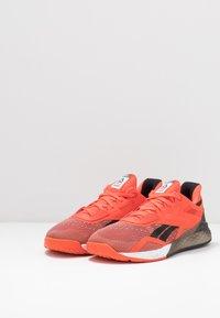 Reebok - NANO X - Sports shoes - vivdor/black/white - 2