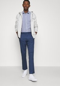 Polo Ralph Lauren - STRETCH SLIM FIT COTTON CHINO - Pantalon classique - rustic navy - 3