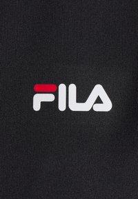 Fila - CEARA TIGHT DRESS - Pouzdrové šaty - black - 6