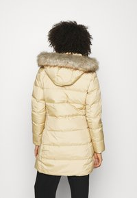Tommy Hilfiger - BAFFLE COAT - Down coat - yellow stone - 2