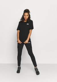 The North Face - INTERNATIONAL WOMENS DAY TEE - T-shirts med print - black - 1