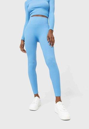 NAHTLOSE - Leggings - Trousers - blue