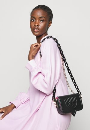 SMALL EYELIKE BAG - Across body bag - black