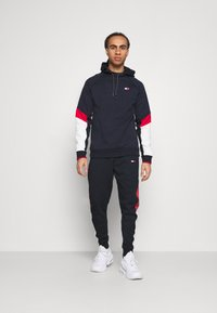 Tommy Hilfiger - CUFFED BLOCKED PANT - Tracksuit bottoms - blue - 1